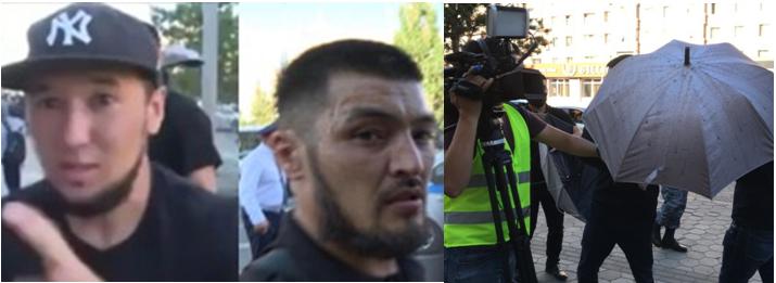 """""""Tituszki"""": Azamat Shaykemelov (po lewej) i Zhiger Abilov (po prawej). Mężczyźni byli jednymi z tych, którzy używali parasoli, aby uniemożliwić dziennikarzom filmowanie. Zdjęcie: zrzut ekranu z nagrania należącego do Radia Azattyk."""